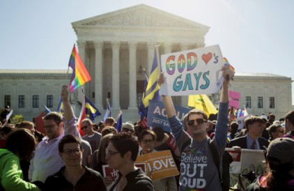 Supporters of same sex marriage rally in front of the Supreme Court before the court hears arguments about gay marriage