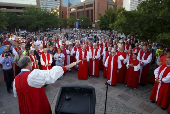 Approximately 60 Episcopal bishops prepare to lead hundreds of marchers through the streets to protest against gun violence as part of their convention in Salt Lake City, Utah June 28, 2015. The march was part of the General Convention of the Episcopal Church, which is held every three years in different cities around the country.  REUTERS/Jim Urquhart - RTX1I5KJ
