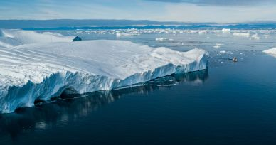 Climate Change and Global Warming - Icebergs from melting glacier on Greenland